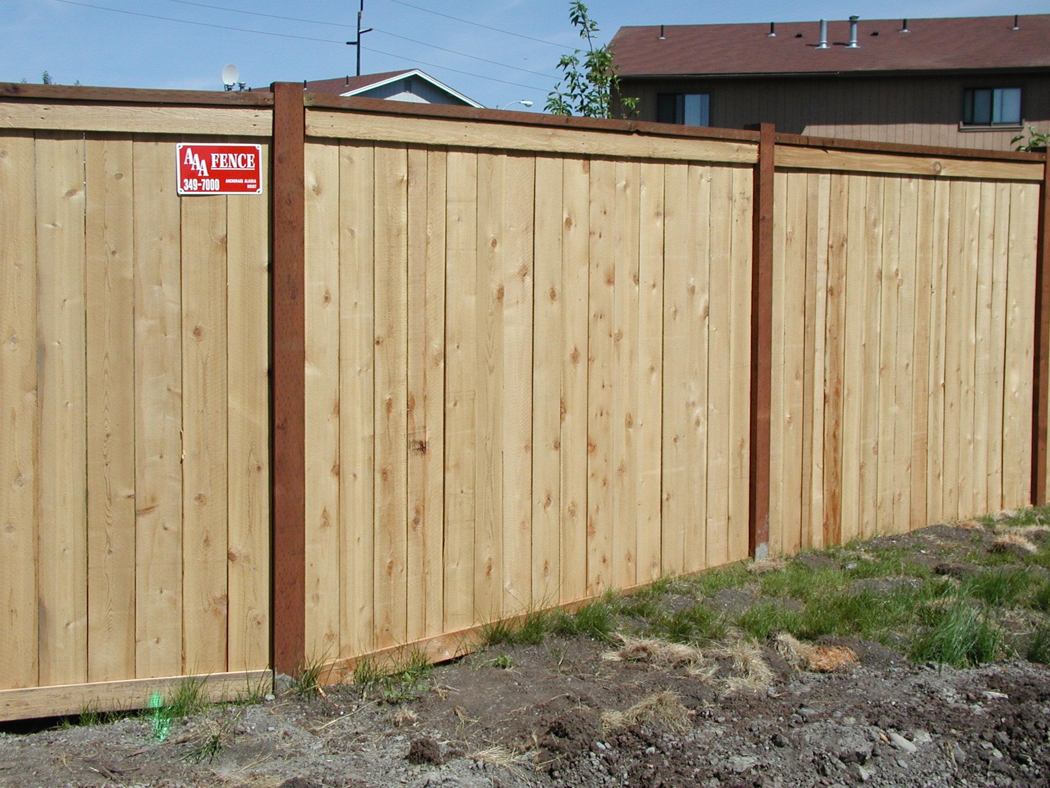Cedar plank fence